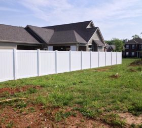 Standard white vinyl privacy fence