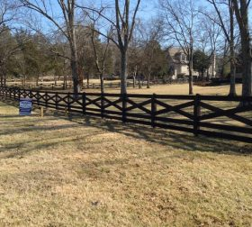 Custom black split rail wood fence