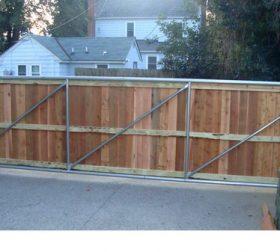 Automatic wood driveway gate