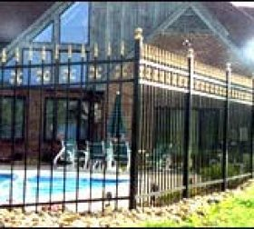Aluminum pool fence with brass pickets