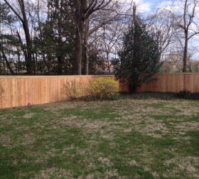 Wood privacy perimeter fence