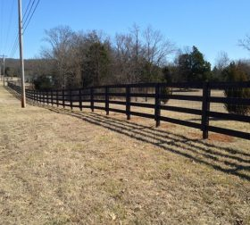 Black wood split rail fence