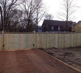Wood privacy fence and automatic driveway gate