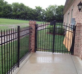 Aluminum fence with arched gate & brick posts