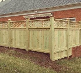 Wood privacy fence with bottom extension