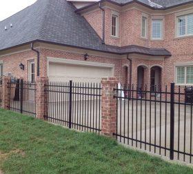 Aluminum fence with custom brick posts