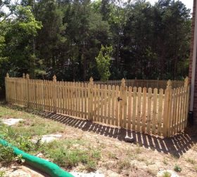 Wood picket fence with custom posts