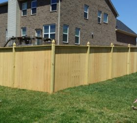 Wood privacy fence with custom posts