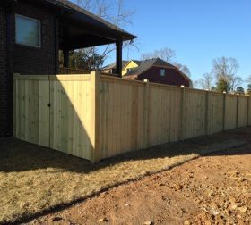 Newly built tall wood privacy fence