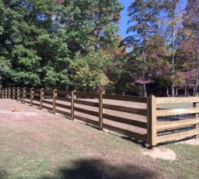 Split rail wood fence with mesh wire
