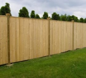 Tall wood privacy fence
