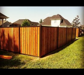 Stained wood tall privacy fence