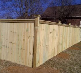 Tall wooden privacy fence