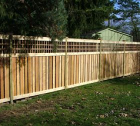 Wooden privacy fence with lattice