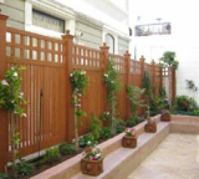 Wood privacy fence stained